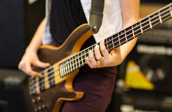 Close up of musician with guitar at music studio Stock Images
