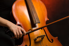 Close up musician hands with cello Stock Photos