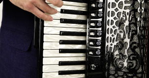 Close-up of a musician playing the accordion. stock footage