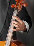 Musician playing the cello. Close-up of a musician playing the cello classical music, on a dark background Stock Photography
