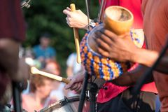 Close up of musician playing drum at Klezmer concert of Jewish fusion music in Regent`s Park in London. Close up of musician playing drum at Klezmer concert of royalty free stock photo