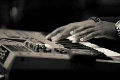 Musician playing keyboard hands only stock images