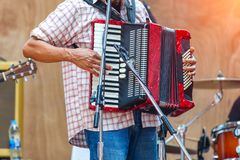 Close up musicians are playing accordion on stage.  stock images