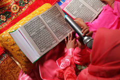 Close up muslim child and book Stock Images