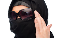 Close up of muslim woman in hijab and sunglasses. Accessory, fashion and people concept - close up of muslim woman in hijab and sunglasses over white background Stock Images