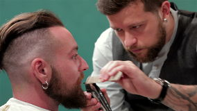 Close up of a mustache trimming. In barbershop stock video footage