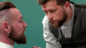 Close up of a mustache trimming. In barbershop stock footage