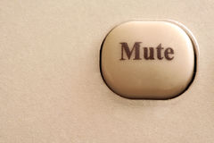 Close up of a mute button Royalty Free Stock Images