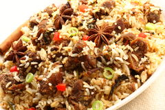 Close up of mutton biriyani. Mutton biriyani-It is a medley of rice,mutton vegetables  The rice is browned in oil and then mixed with vegetables, spices, nuts Royalty Free Stock Image