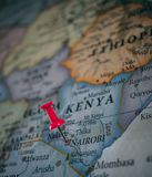 Close up of Nairobi pin pointed on the world map with a pink pushpin royalty free stock photos