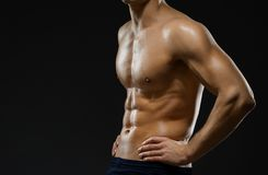 Close up of naked male's chest. Isolated on black Stock Photos