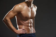 Close up of naked male's torso. Isolated on black Stock Photo