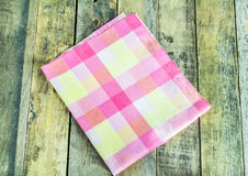 Close up napkin on wooden background Royalty Free Stock Photo