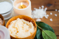 Close up of natural body scrub and candle on wood Royalty Free Stock Photo