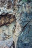 Close up natural do fundo da textura do penhasco da rocha Imagem de Stock