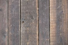 Close-up of natural old vintage weathered gray brown unpainted solid wooden fence or gate of planks and boards. Ecological texture stock photos