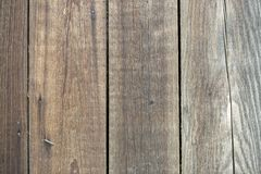 Close-up of natural old vintage weathered gray brown unpainted solid wooden fence or gate of planks and boards. Ecological texture royalty free stock photos