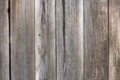 Close-up of natural old vintage weathered gray brown unpainted solid wooden fence or gate of planks and boards. Ecological texture stock images