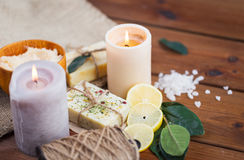 Close up of natural soap and candles on wood Royalty Free Stock Images
