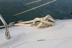 Close-up nautical knot rope tied around stake on boat or ship, boat mooring rope Stock Photos