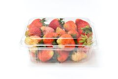 Close up near ripe red strawberry in plastic transparency pack, isolated on white background. Close up near ripe red strawberry in plastic, transparency pack Stock Photography