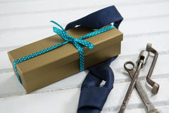 Close up of necktie and gift box by work tools Stock Photo