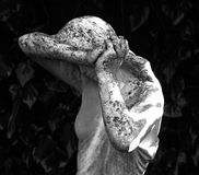 Close up of a neglected classical style stone statue of a beautiful woman in sadness. A black and white image of an old classical style stone statue found Royalty Free Stock Photo