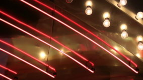 Close Up Neon and Chasing Lights Loop. A looping close up of chasing lights and neon tubes stock footage