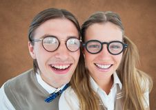 Close up of nerd couple against brown background with grunge overlay Stock Photography