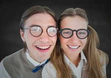 Close up of nerd couple against grey wall. Digital composite of Close up of nerd couple against grey wall Royalty Free Stock Images