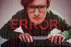 Close up of nerdy guy and red error text Royalty Free Stock Photo