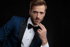 Close up of a nervous groom wearing a blue tuxedo stock photos