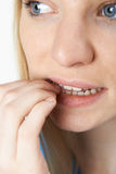 Close Up Of Nervous Woman Biting Nails stock images