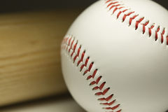 Close up of a new baseball and wooden bat Stock Photos