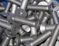 Close up of new bolts. Background Royalty Free Stock Photography