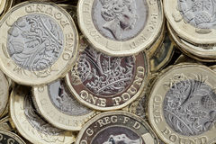 Close up of new British pound coins. Untidy pile of the new coins introduced in March 2017 that have several new security features to help prevent fraud