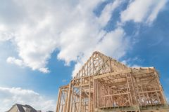 Close-up new build gables roof wooden truss, post, beam framewor. Close-up new build roof wooden truss, post and beam framework. Gables roof on stick built home Royalty Free Stock Images