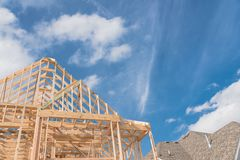Close-up new build gables roof wooden truss, post, beam framewor. Close-up new build roof wooden truss, post and beam framework. Gables roof on stick built home Royalty Free Stock Photo