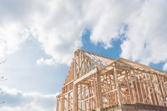Close-up new build gables roof wooden truss, post, beam framewor. Close-up new build roof with wooden truss, post and beam framework. Gables roof on stick built Royalty Free Stock Image