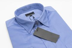 Close up of new business shirt for men. On white background Royalty Free Stock Photography