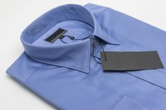 Close up of new business shirt for men. On white background Royalty Free Stock Image