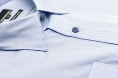 Close up of new business shirt for men on white Royalty Free Stock Images