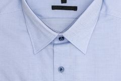 Close up of new business shirt for men on white Royalty Free Stock Photography