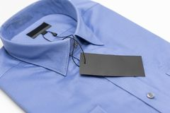 Close up of new business shirt for men. On white background Stock Images