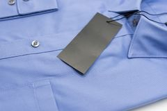 Close up of new business shirt for men. On white background Royalty Free Stock Photos