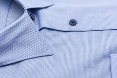 Close up of new business shirt. For men on white background Royalty Free Stock Photography