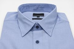 Close up of new business shirt. For men on white background Stock Photos