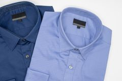 Close up of new business shirt for men. On white background Royalty Free Stock Photo