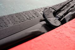 Close-up of a new, hybrid vehicle showing the windscreen and central wiper blade assembly. stock images