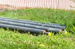 Close up of new insulated pipes for water district heating sewage or gas with insulation on the pipeline reconstruction site on th. E street in the city stock photos